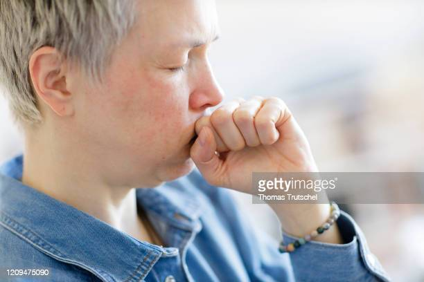 Symbolic image on the subject of nausea A woman is about to vomit on April 05 2020 in Berlin Germany