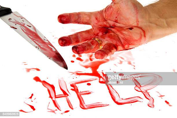 symbolic photo crime murder bloody hand knife and lettering help 2010