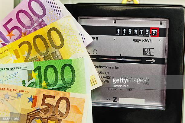 symbolic photo electricity rate electricity meter and Euro banknotes