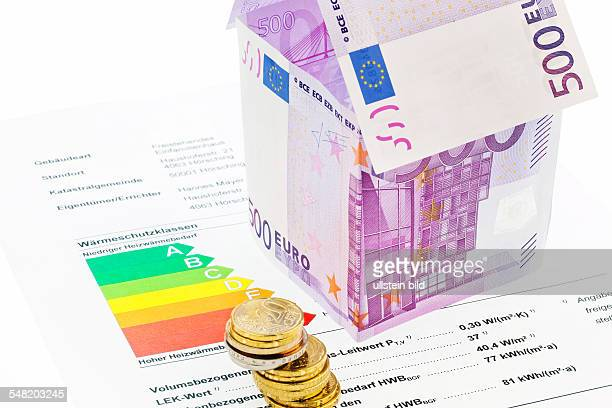 symbolic photo energy costs thermal insulation house made of 500 Eoro banknotes and energy pass