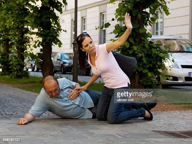 symbolic photo heart attack woman is seeking aid