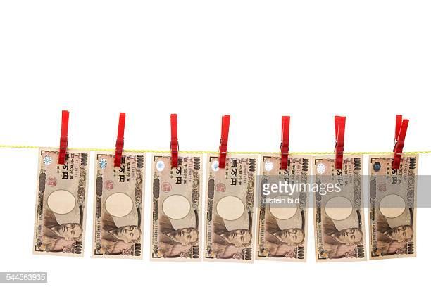 symbolic photo money laundering Japanese Yen banknotes on a cloth line
