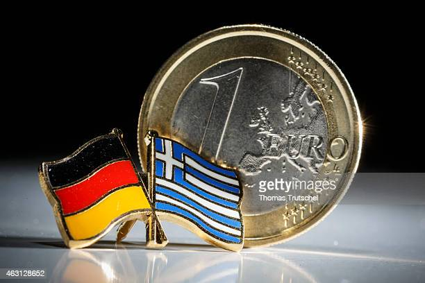 Symbolic photo of Greece and the Euro one euro coin behind a badge with the national flags of Greece and Germany on February 10 2015 in Berlin Germany