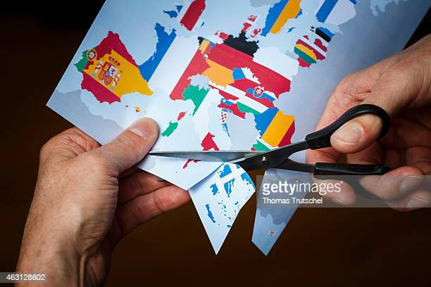 Symbolic photo of the Greek withdrawal from the eurozone Grexit person cutting out Greece from a map with the EU member states on February 10 2015 in...