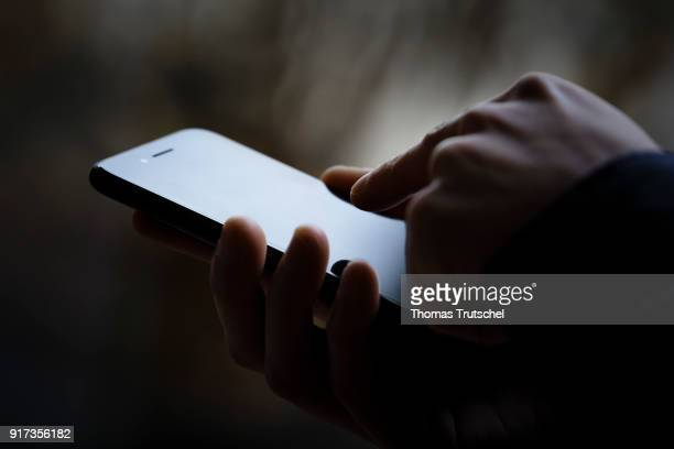 Symbolic photo on the subject of data security on the smartphone Hands are typing on a smartphone on February 12 2018 in Berlin Germany