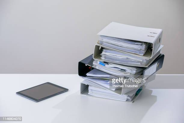 Symbolic photo on the subject of ' digitization in administration ' A tablet computer is lying next to a pile of folders on May 29 2019 in Berlin...
