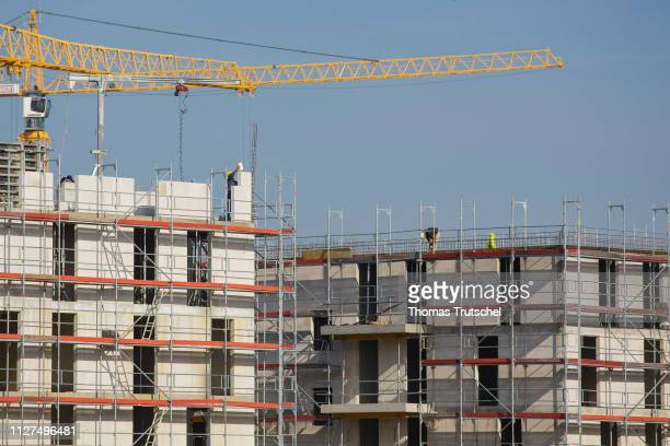 Symbolic photo on the subject of housing construction Rough buildings of residential houses stand on a construction site in Berlin Schoenefeld on...