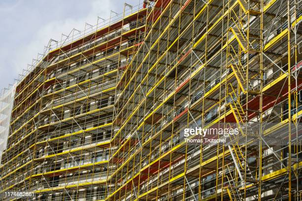 Symbolic photo on the subject of housing construction Rough buildings of residential houses stand on a construction site in Berlin Schoeneberg on...