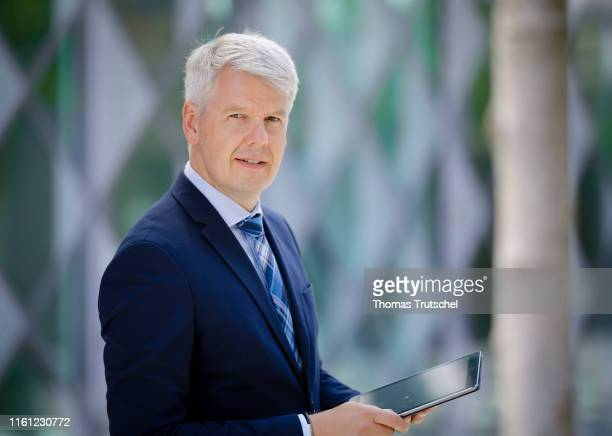 Symbolic photo on the topic of businessman A businessman with a tablet in his hand looks at the camera on August 09 2019 in Berlin Germany
