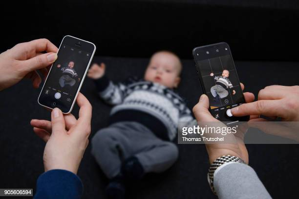 Symbolic photo on the topic of education A baby is photographed with two smartphones on January 16 2018 in Berlin Germany