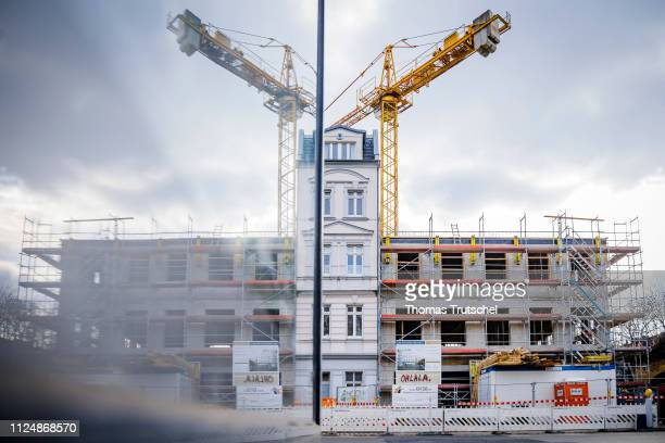 Symbolic photo on the topic of housing construction A new residential building will be built next to an old building on February 14 2019 in Berlin...