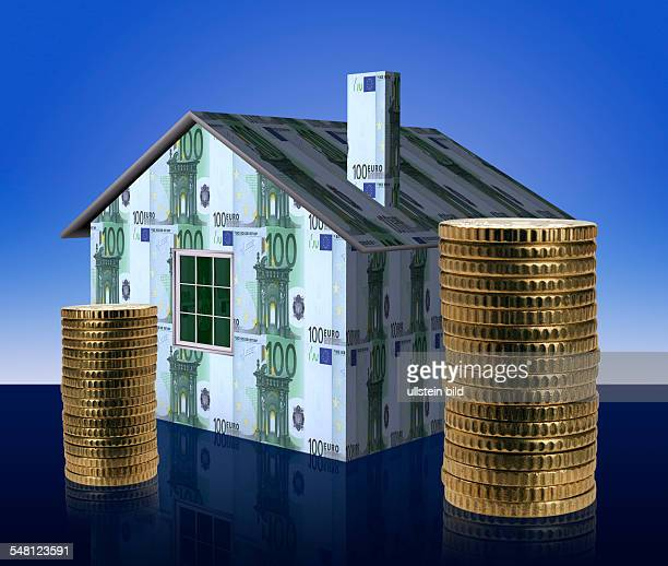 symbolic photo Real Estate mortgaging building law house made of Euro banknotes and Euro coins montage