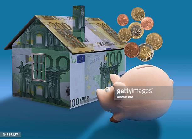 symbolic photo Real Estate mortgaging house made of Euro banknotes and piggy bank montage