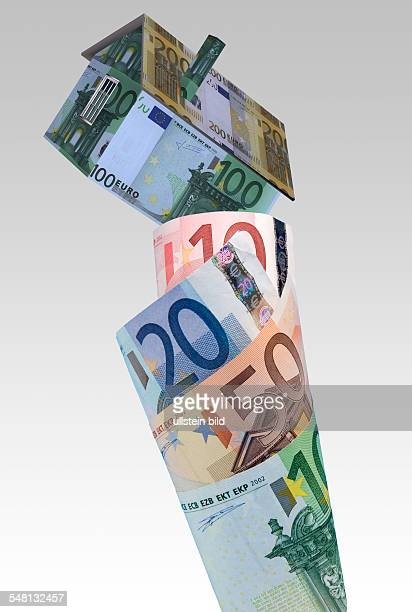 symbolic photo Real Estate mortgaging house on Euro banknotes montage