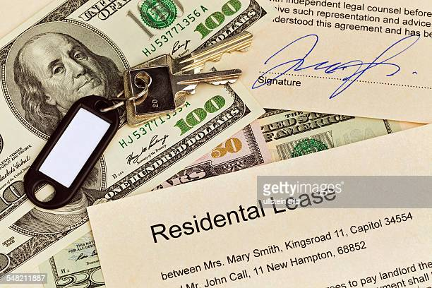 symbolic photo residental lease in English dollar banknotes and keys