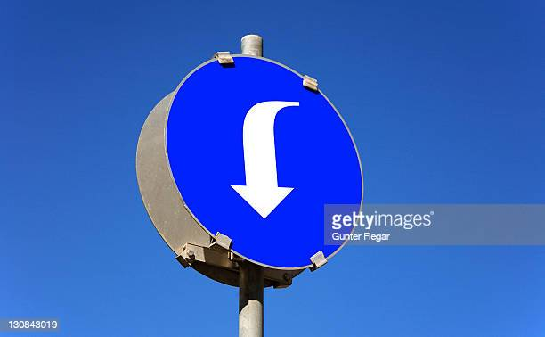 symbolic photo - traffic sign - arrow down - curved arrows stock pictures, royalty-free photos & images