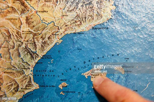 symbolic photo travel geography finger on a map Majorca Balearic Islands