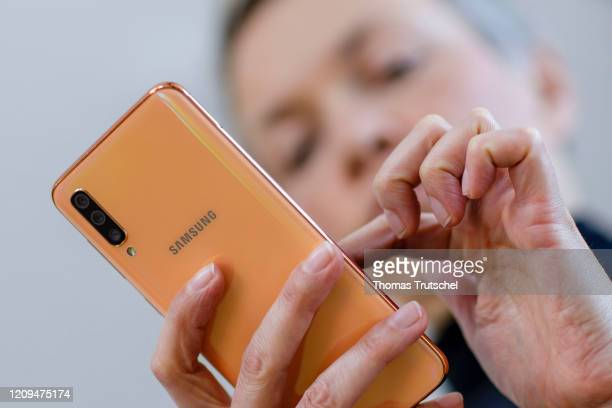 Symbolic photograph A woman types on a Samsung smartphone on April 06 2020 in Berlin Germany