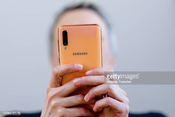 Symbolic photograph. A woman types on a Samsung smartphone on April 06, 2020 in Berlin, Germany.