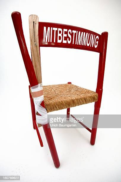 Symbolic picture broken chair with the writing Mitbestimmung