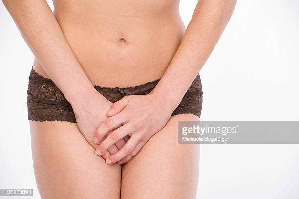 Symbolic picture of young woman experiencing urinary incontinence