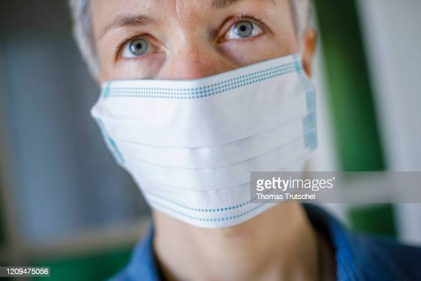 Symbolic picture on the subject of prevention A woman wears a mouth guard on April 05 2020 in Berlin Germany Many people currently equip themselves...