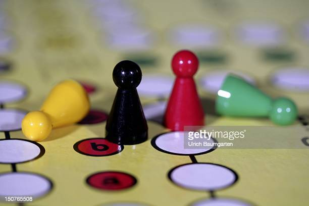 Symbolic picture Politics parties in Germany Play figures in the colours yellow black red and green on the playboard of the German board game Do not...