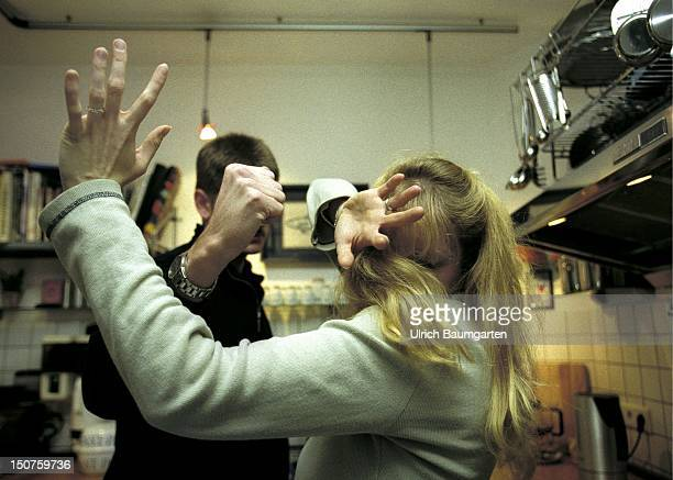 Symbolic picture violence in the marriage domestiv violence A man beating his wife in the kitchen