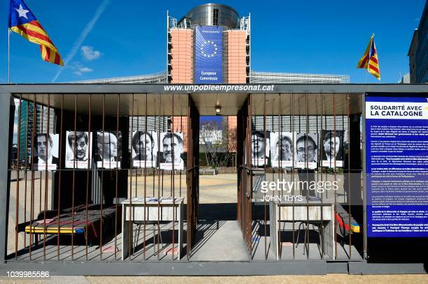 A symbolic prison with portraits of political Catalan prisoners is set up at Place Schuman in front of the EU Commission in Brussels on September 25...