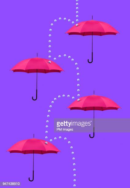 Symbolic rain cascading down four umbrellas