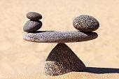 Symbolic scale of the stones. Concept of harmony and balance. work-life, emotional balance.