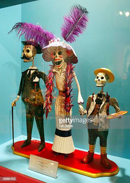 A symbolic skeleton family of three is displayed at the Dia de los Muertos exhibition October 31 2003 at the Mexican Fine Arts Center Museum in...