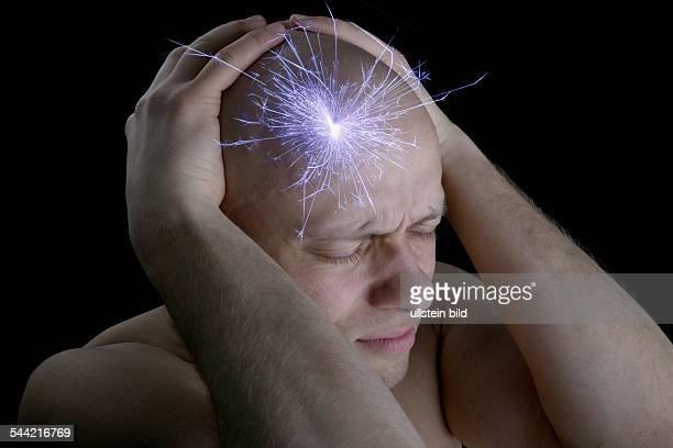 Symbolische Darstellung von Schmerz bei einem MenschenKopfschmerzen Migräne