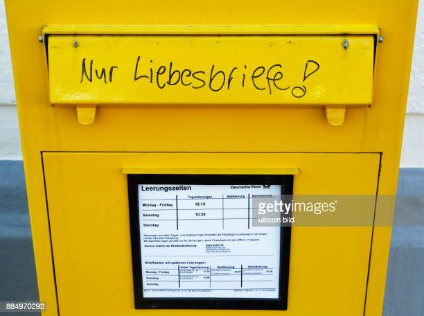 symbolism humour fun love yellow letterbox with the inscription 'love letters only' Federal Post Office Germany