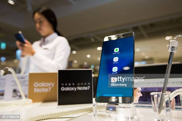 Symbols including the battery icon are displayed on the screen of a Samsung Electronics Co Galaxy Note 7 smartphone at one of the company's...
