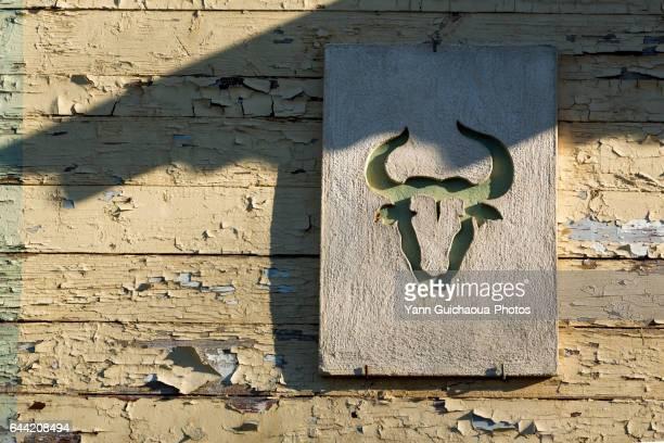 Symbols of Camargue on a facade