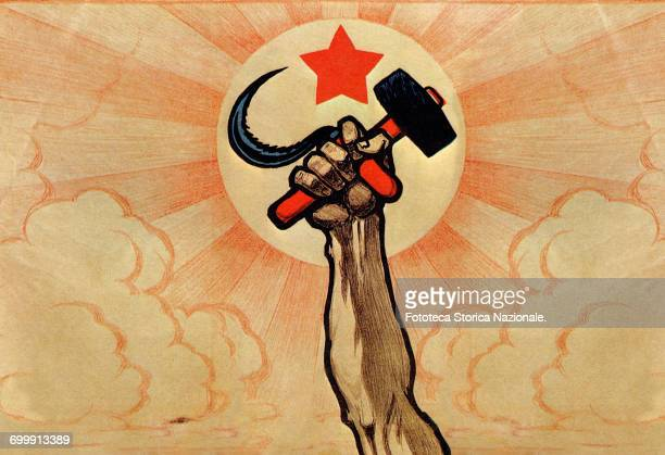 the hand wielding the hammer and sickle in the background the rising sun and the red star Color lithograph Digital optimization from detail of a Ivan...