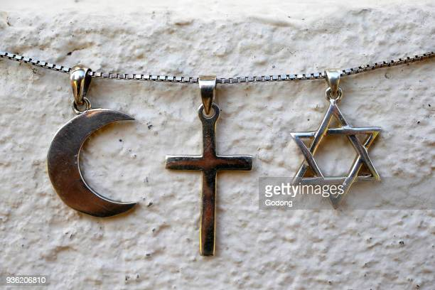 Symbols of islam christianity and judaism