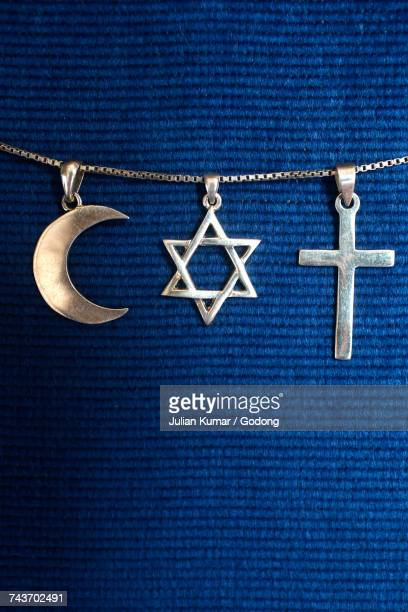 Symbols of islam, judaism and christianity. France.
