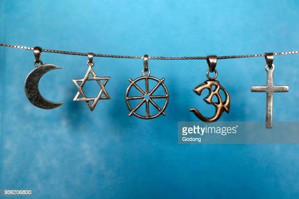 Symbols of islam, judaism, buddhism, hinduism and christianity.