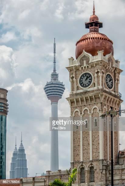 symbols of kuala lumpur malaysia: sultan abdul samad building , petronas twin towers and kl tower - menara kuala lumpur tower stock photos and pictures