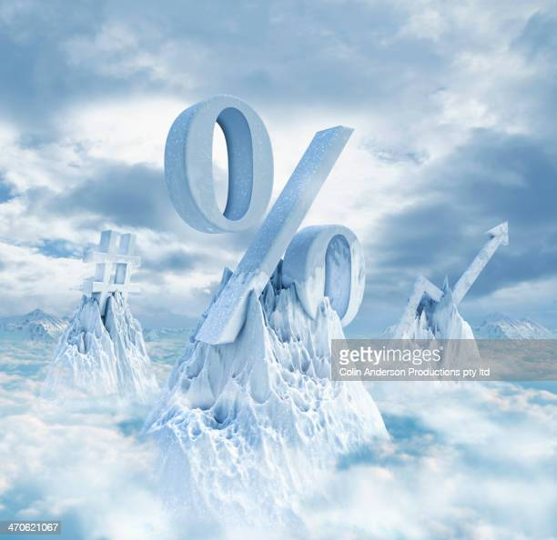 symbols on snowy mountaintops - interest rate stock pictures, royalty-free photos & images
