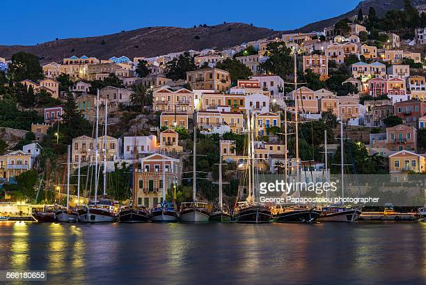 symi island at night - symi stock photos and pictures