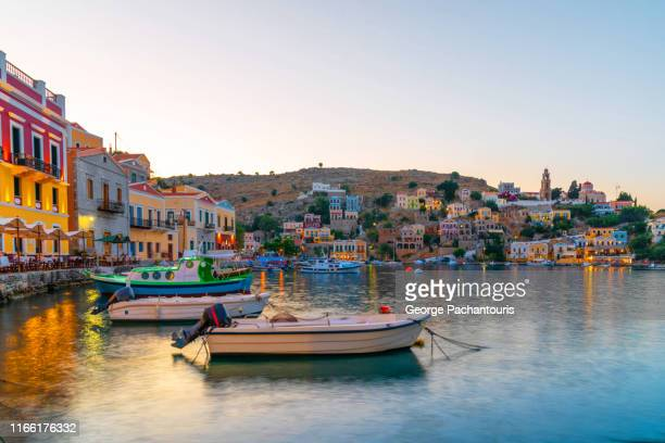symi town at dusk - aegean sea stock pictures, royalty-free photos & images