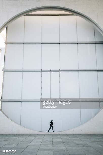 Symmetrical picture of woman running.