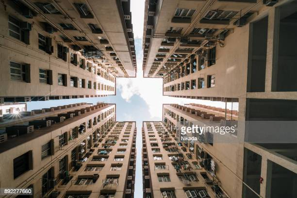 symmetrical residential buildings in hong kong, china - council flat stock pictures, royalty-free photos & images