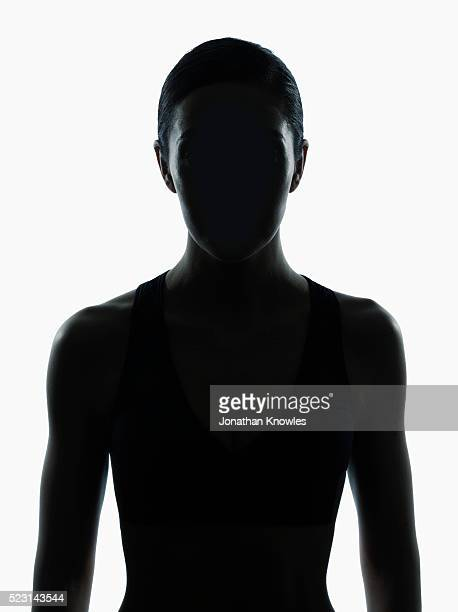 Symmetrical studio shot of female silhouette, white background