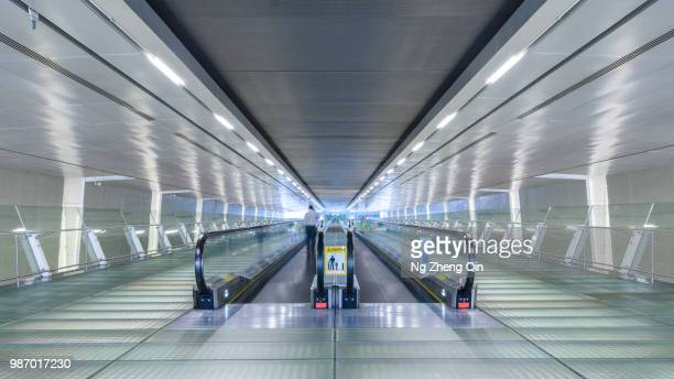 symmetry - pedestrian walkway stock pictures, royalty-free photos & images