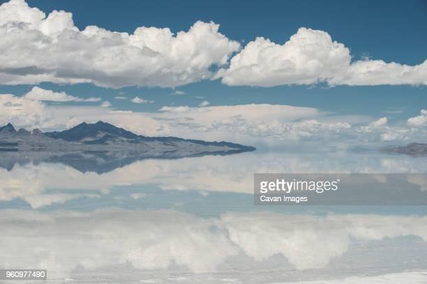 symmetry view of bonneville salt flats against cloudy sky - bonneville salt flats stock pictures, royalty-free photos & images