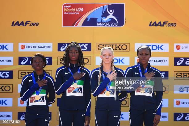 Symone Mason Shae Anderson Julia Madubuike and Taylor Manson of The USA celebrate with their medals during the medal ceremony for the women's 4x400m...